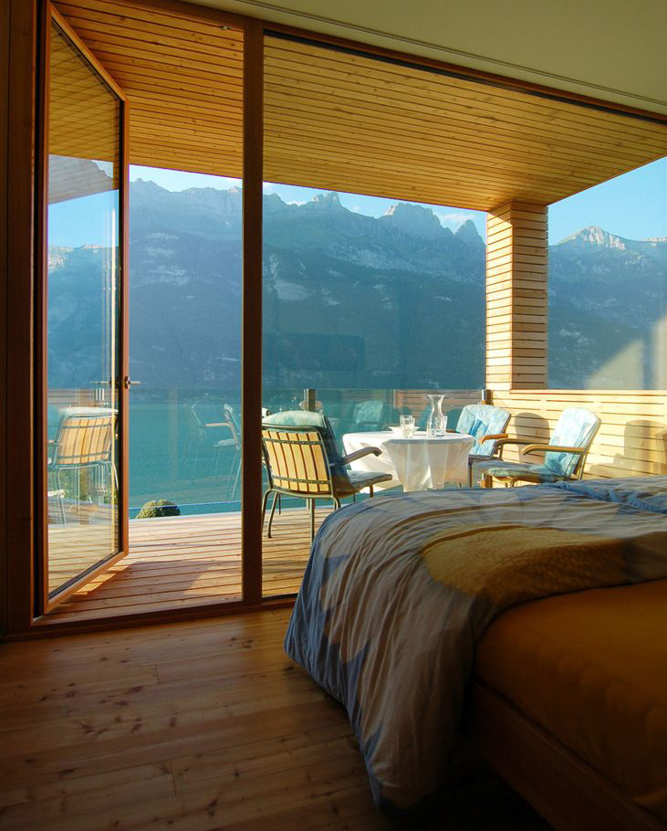 Wood bedroom interior design in switzerland for Wooden interior design for bedroom