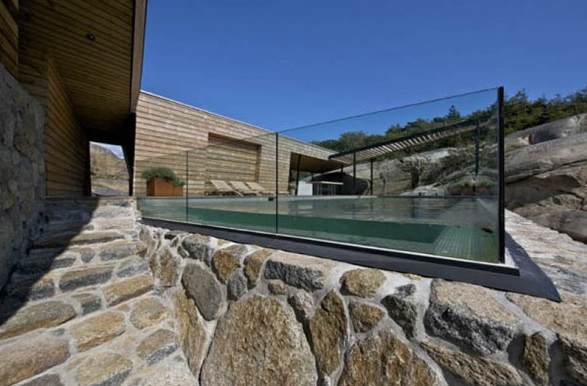 Outdoor Swimming Pool Design With Wooden And Stone Materials