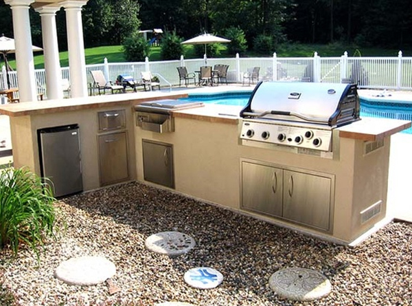 contemporary outdoor kitchen design with swimming pool