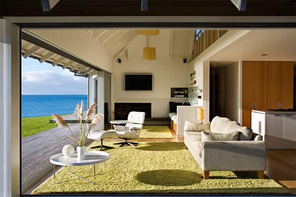 Beach house with relaxation outdoor furnitures in for Coastal home designs nz