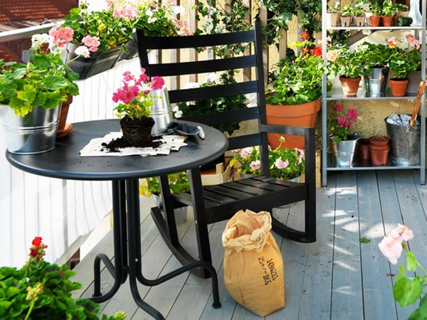 small-outdoor-furniture-balcony-with-flower-decoration