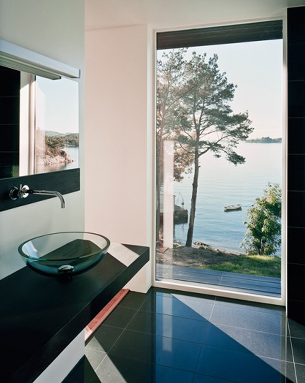 Scandinavian bathroom design with view of the beach for View bathroom designs