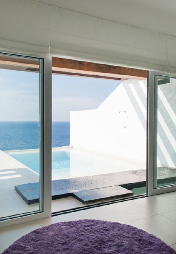 white-beach-house-with-glass-door-located-in-spain