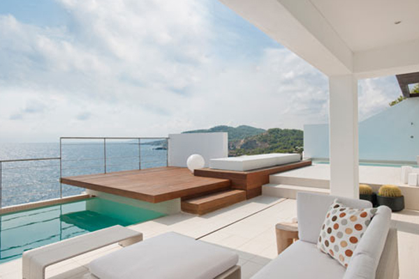 white-beach-house-with-outdoor-furniture-by-juma-architects
