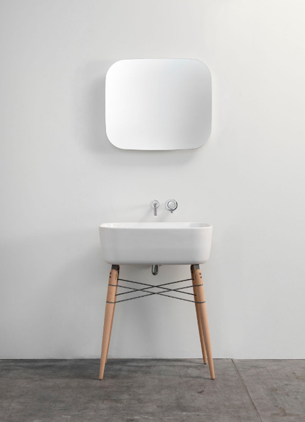 white-ceramic-washbasin-with-mirror-by-michael-hilgers