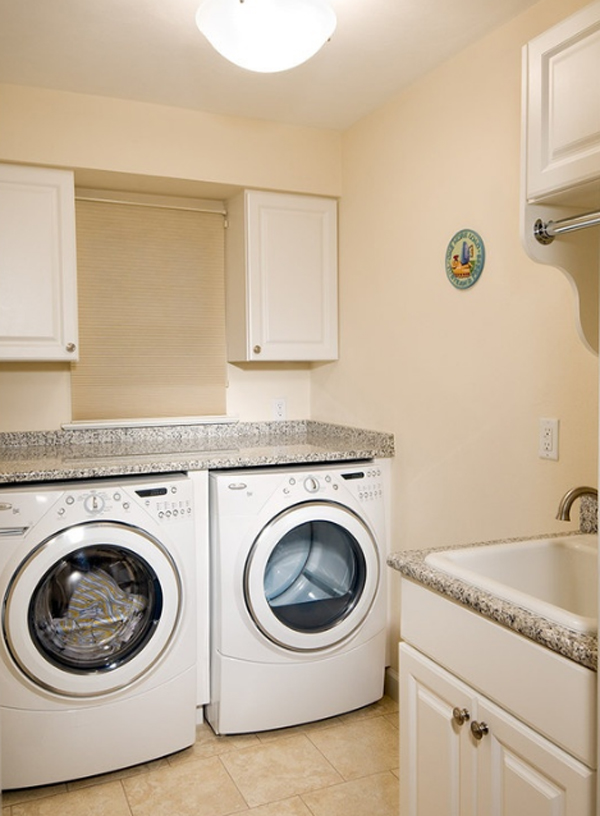 20 small laundry room makeovers with small space solutions for Small bathroom laundry designs