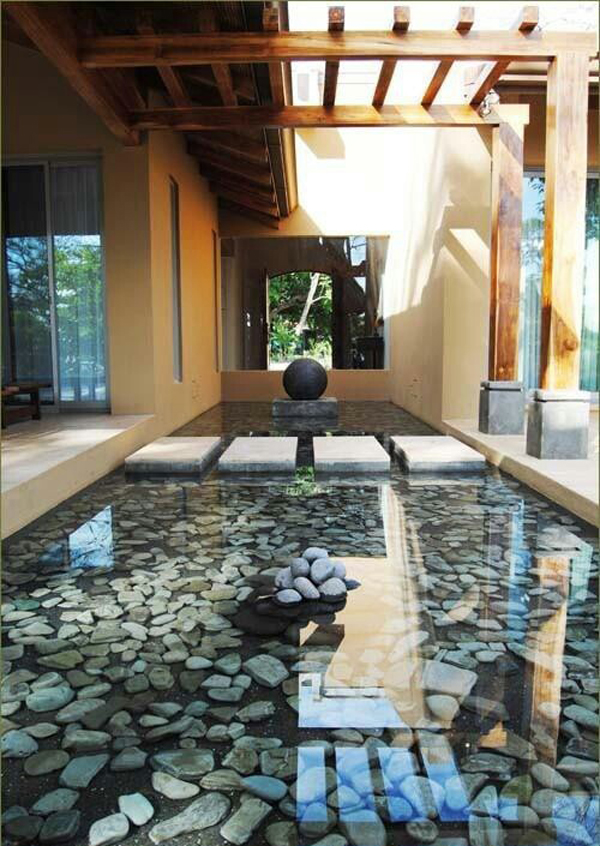 20 wonderful indoor ponds home design and interior for Indoor pond design