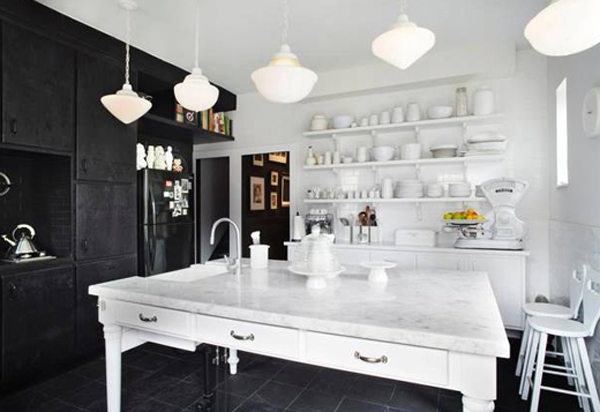 The kitchen uses black and white theme, good kitchen arrangement and