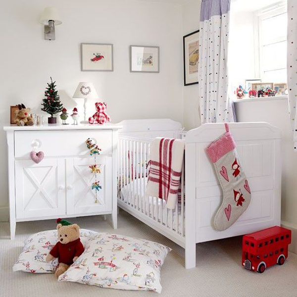 a red and white theme is a staple to christmas this lovely room is decorated beautifully with a red and white stockings bedding and stuffed toys