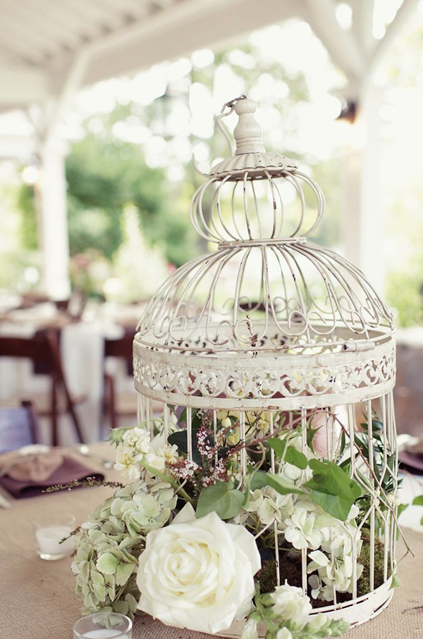 cheap wedding decorations baby breath white flowers in vintage cage centerpiece blush floral art Find this Pin and more on BIRDCAGES by 💝JAX💝 & ANNE (NO PIN LIMITS). 33 Elegant Birdcage Wedding Centerpieces a bird cage on legs with a heart topper and baby's breath inside.