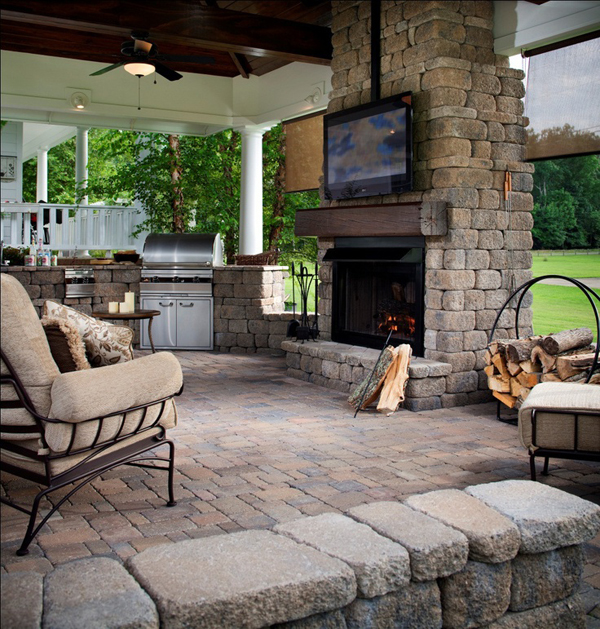 Cozy outdoor living space with tv stand furniture for Outdoor room with fireplace