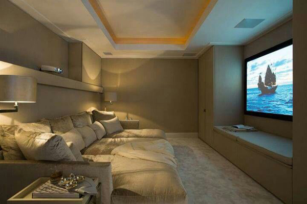 basement media room with movie poster niches on the walls pictures to