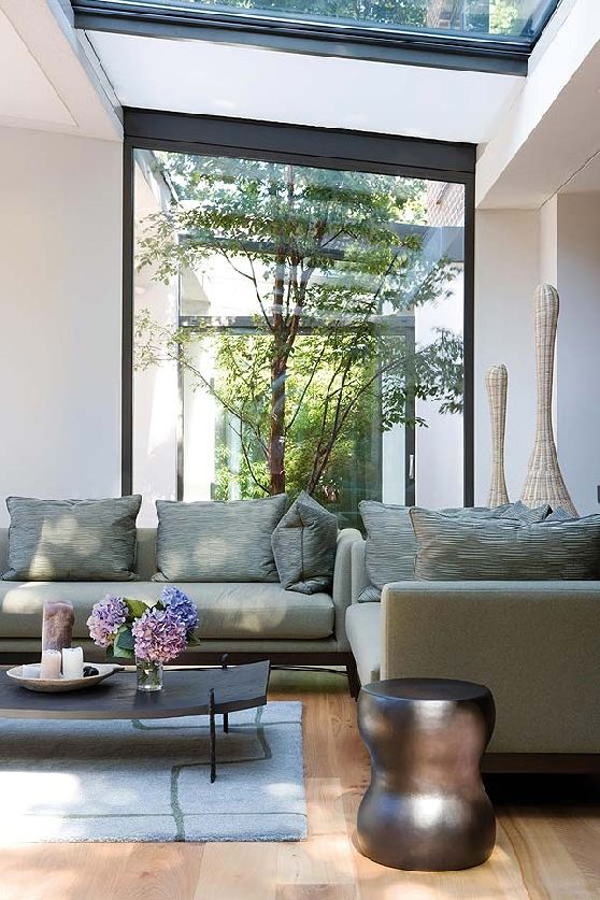 living room with indoor courtyard garden view