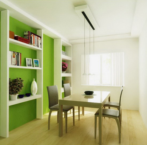green dining room with wall storage unit