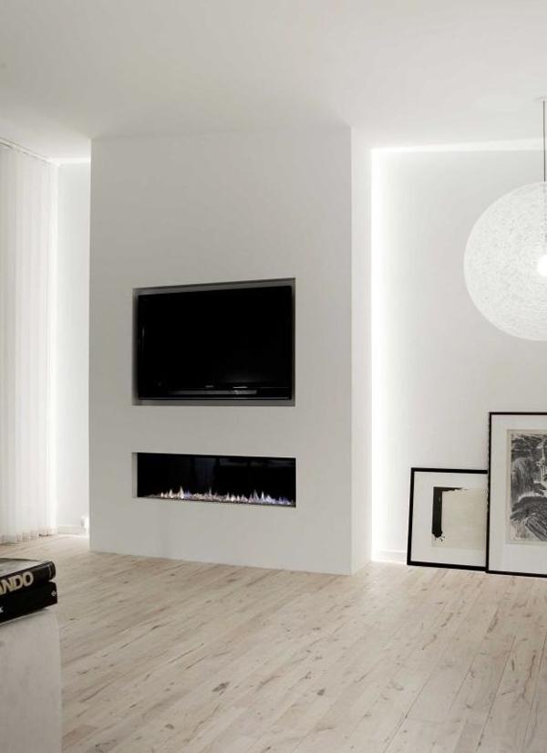 tv wall  hidden fireplace