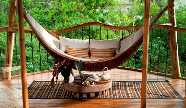 bamboo tree house with hanging chairs