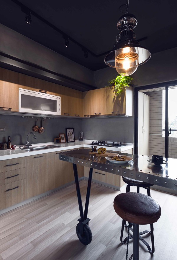 Gallery of Marvel Heroes Themed Apartments With Industrial Touch & marvel-riveted-kitchen-countertop