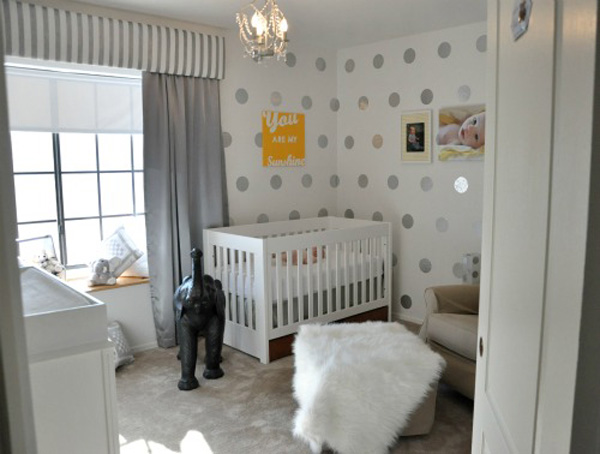 white polka dot baby room