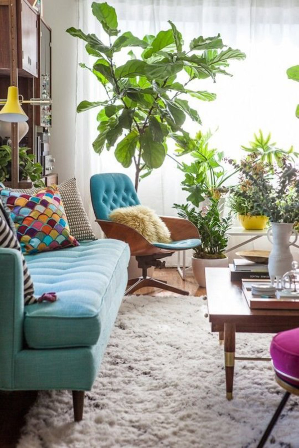 10 wonderful rooms with urban jungle home design and interior for Living room with indoor plants