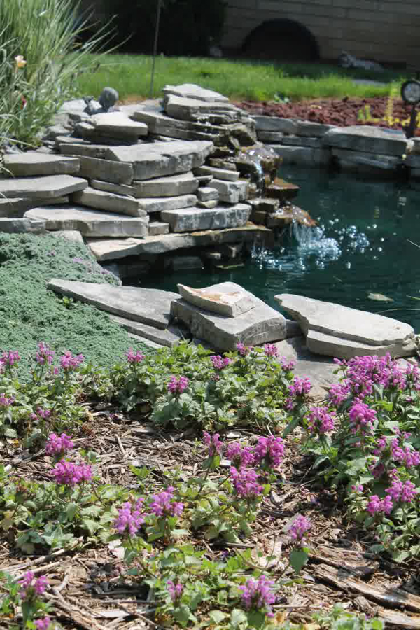 Stone backyard pond ideas for Stone koi pond
