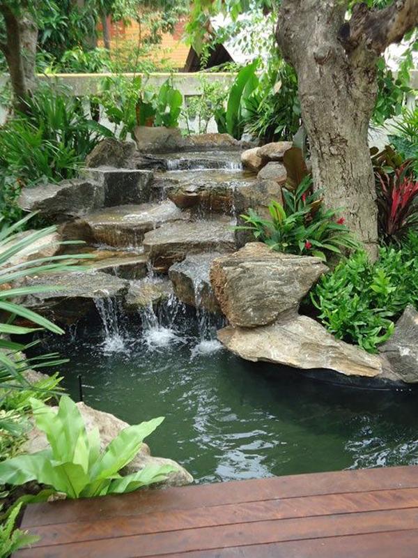 Backyard Waterfalls With Wood Deck