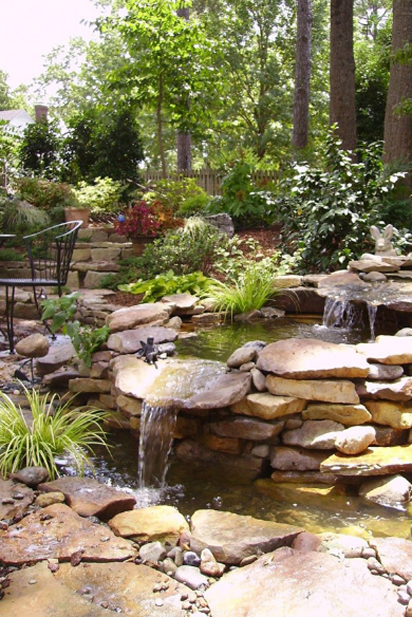 Waterfall garden for koi pond for Garden pond stones
