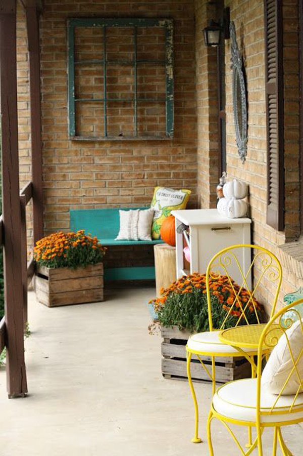 Cozy Front Porch With Pops Of Yellow Homemydesign