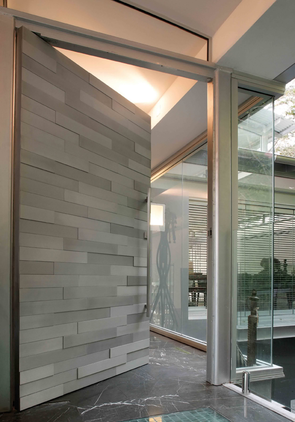 Textural tiled front door for House entrance designs interior