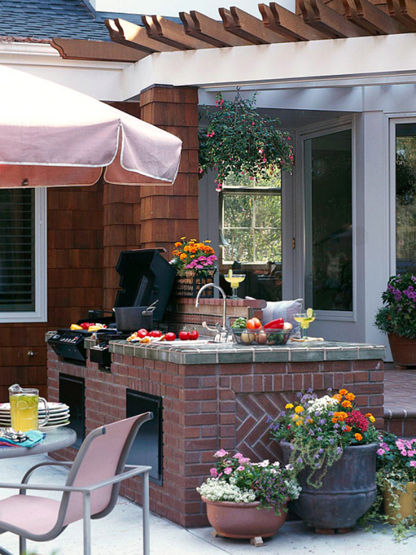 Outdoor kitchen with flower garden for Summer kitchen plans