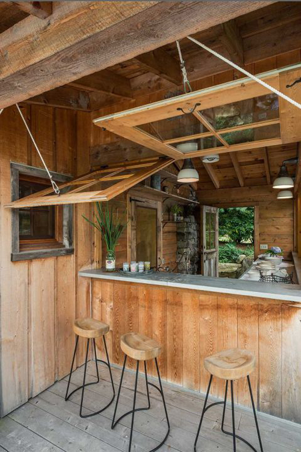Wooden dining with outdoor kitchen for Outdoor kitchen and dining