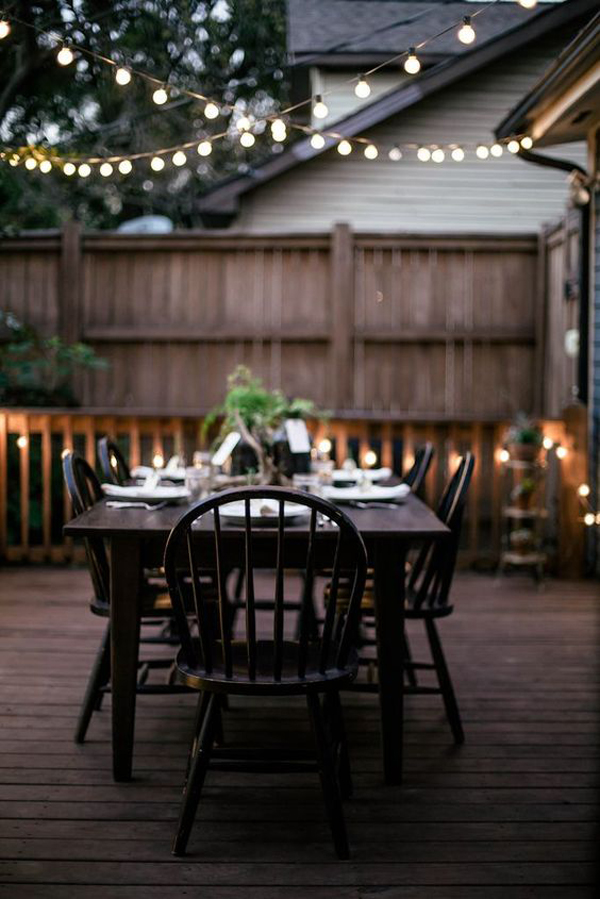 Outdoor patio string lighting with seating areas for Terrace lighting