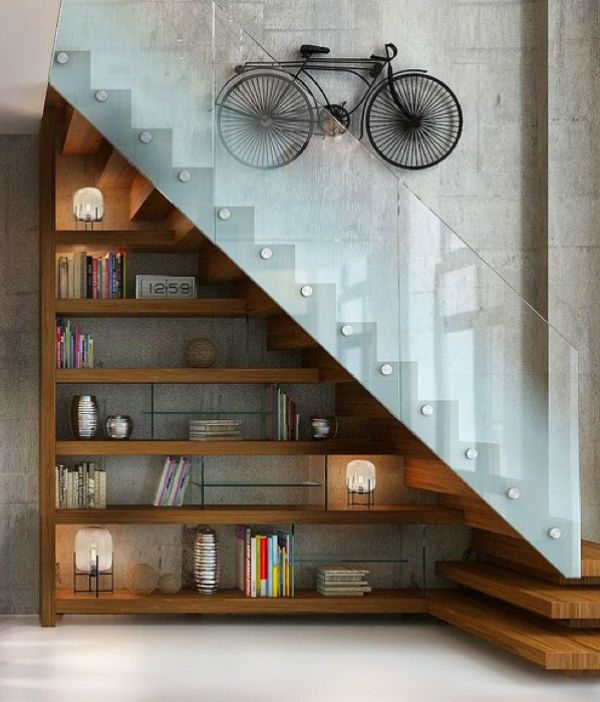 under-stairs-library-with-bike-wall-art