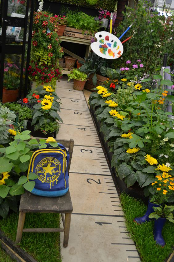 Ruler-footpath-lined-with-sunflowers-garden