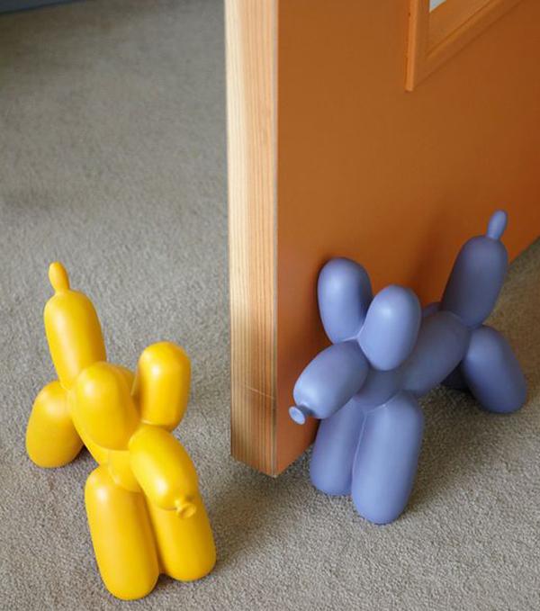 22 creative doorstop ideas with funny character home design and interior - Dog door blocker ...