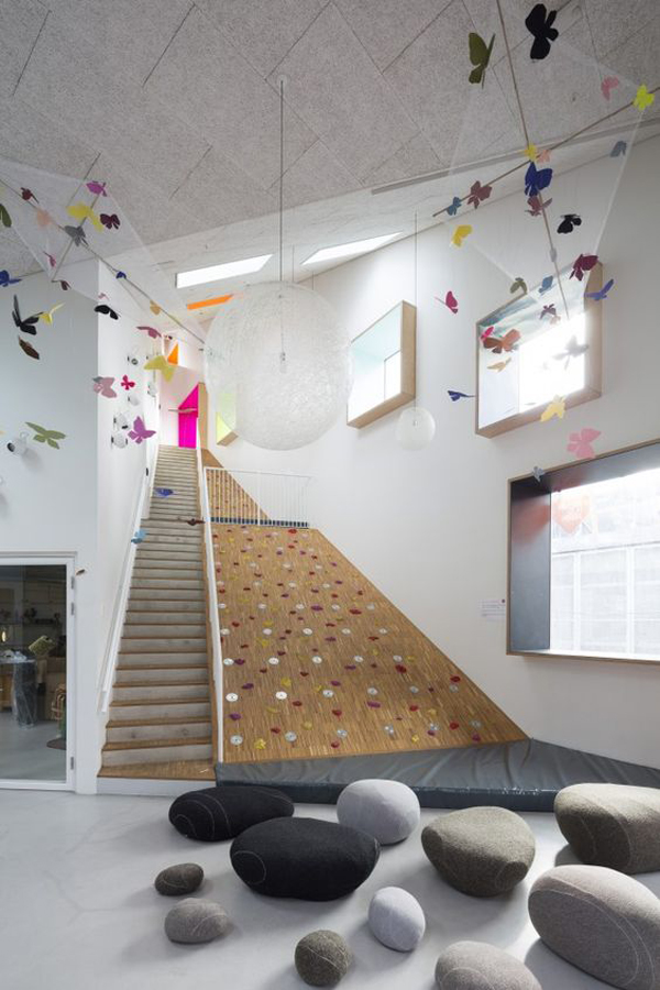 Kids Climbing Wall In The Stairs