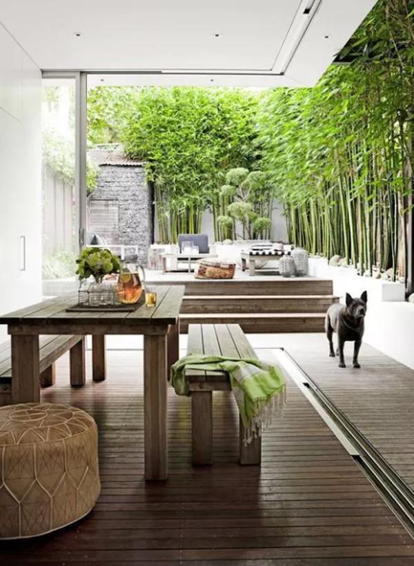 Wooden Indoor Outdoor Dining Area With Tropical Garden
