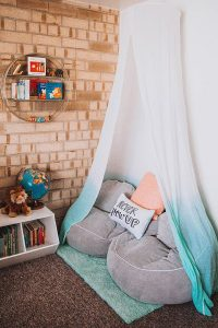 canopy-reading-nook-design-with-exposed-brick