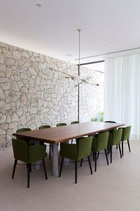 contempory-dining-room-design-with-stone-wall-decor