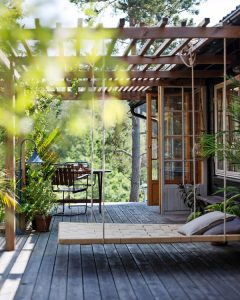 cozy-deck-patio-garden-with-swing-chairs