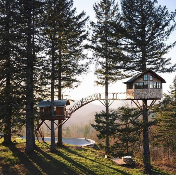 double-romantic-treehouses-with-bridge