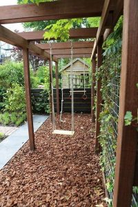 kids-friendly-backyard-garden-with-swings