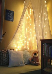 magical-kids-reading-nook-with-string-light