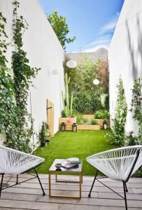 private-patio-garden-with-acapulco-chairs