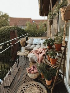 romantic-deck-balcony-with-bed-and-planter-rack