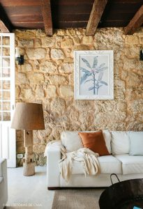 trendy-tropical-living-room-with-stone-walls