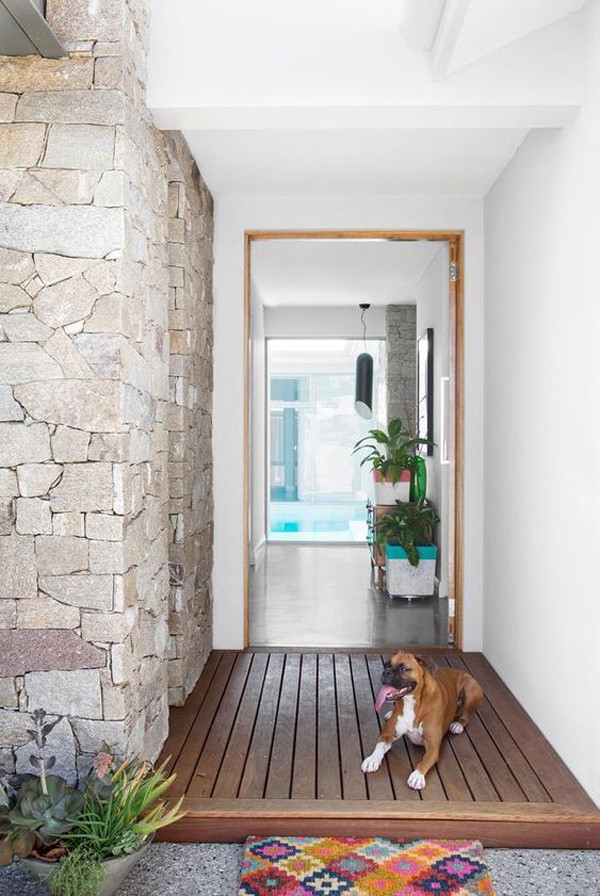 tropical-front-door-design-with-stone-wall