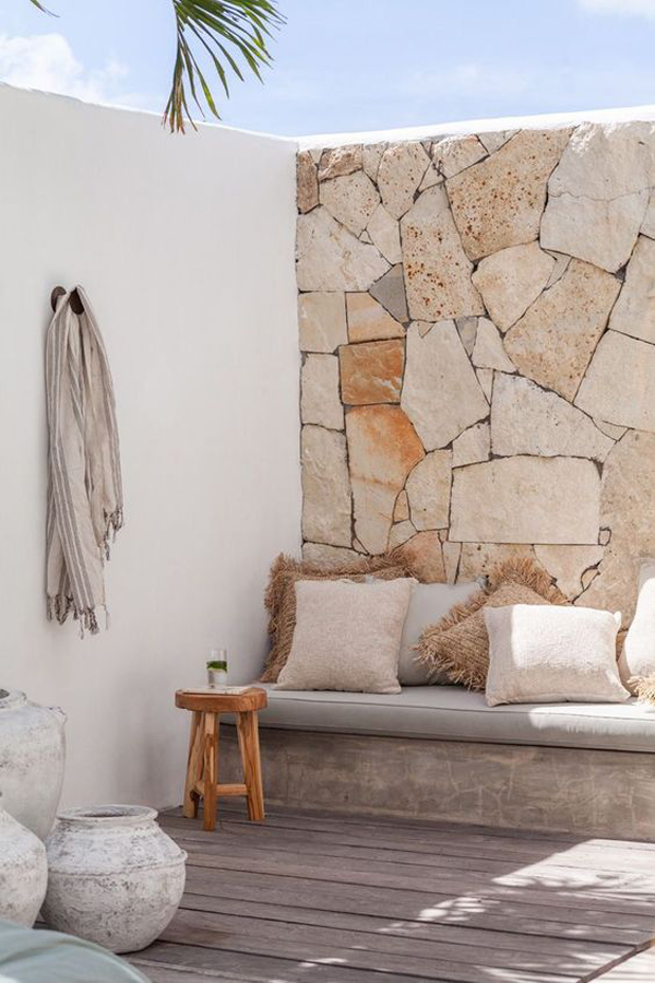 tropical-lounge-area-with-stone-wall