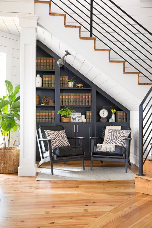 under-stair-bookshelves-with-seating-area