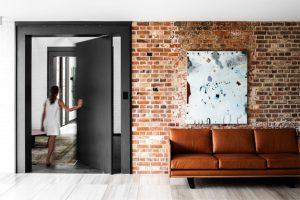 unique-sliding-door-with-leather-sofa