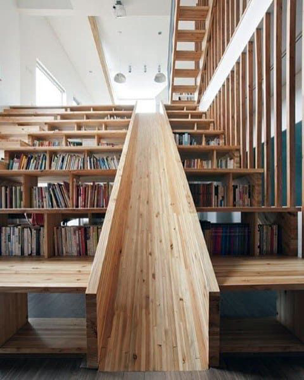 wooden-staircase-with-bookshelf-and-play-slide